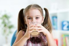 Kid drinking milk from glass Stock Photo