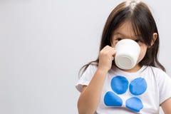 Kid Drinking Milk / Kid Drinking Milk Background / Kid Drinking. Kid drinking milk on studio isolated white background royalty free stock image