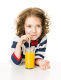 Kid drinking orange juice Royalty Free Stock Photography