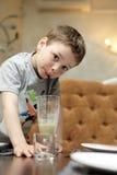 Kid drinking smoothie Stock Image