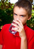 Kid drinking water Royalty Free Stock Image