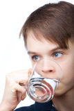 Kid drinking water Stock Images