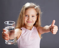 Kid drinking water from glass Royalty Free Stock Photography
