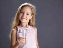 Kid drinking water from glass. Child drinking water from glass royalty free stock photos