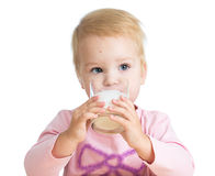 Kid drinking yoghurt from glass Stock Images