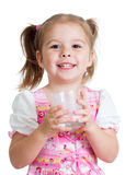 Kid drinking yoghurt from glass isolated Royalty Free Stock Photo