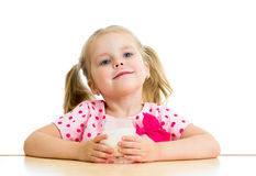 Child drinking yoghurt or milk. Kid drinking yogurt or kefir over white Royalty Free Stock Images