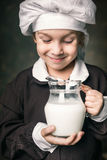 Kid drinks a glass of milk Royalty Free Stock Photo