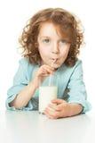 Kid drinks milk stock image