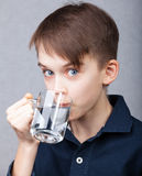 Kid drinks water Stock Photo