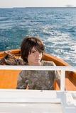 Kid Driving a Boat royalty free stock photos