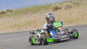 Kid driving go kart Stock Photo