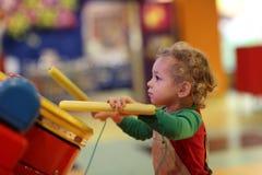 Kid drumming stock photo