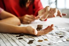 Free Kid Earning Money For Future Royalty Free Stock Images - 108017669