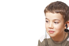 Kid with earphones Royalty Free Stock Images