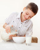Kid eat breakfast Stock Image