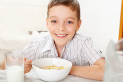 Kid eat breakfast Royalty Free Stock Photography
