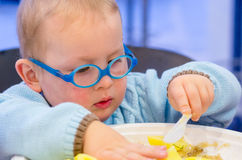 Kid eat dinner Stock Photography
