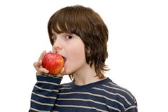 Kid eating an apple Stock Photography