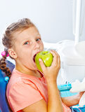 Kid eating an apple Stock Photos