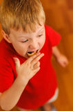 Kid eating bread with bilberry jam Royalty Free Stock Images