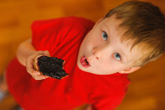 Kid eating bread with bilberry jam Stock Photo