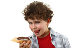 Kid eating bread with peanut butter Royalty Free Stock Image