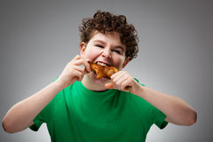 Kid eating chicken leg Stock Photo