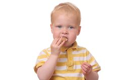 Kid eating cookies Royalty Free Stock Images