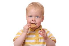 Kid eating cookies Royalty Free Stock Image