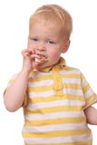 Kid eating cookies Royalty Free Stock Photos