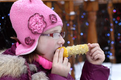 Kid eating corn Stock Photos