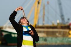 Kid eating fish royalty free stock image