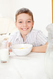 Kid eating frosted flakes Stock Photography
