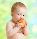Kid eating fruit, healthy food Stock Images