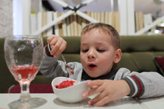 Kid eating fruit ice Royalty Free Stock Images