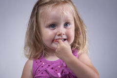 Kid eating gum Royalty Free Stock Photos