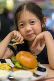 Kid Eating Hamburger Stock Image