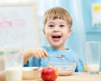 Kid eating healthy food at home Royalty Free Stock Image
