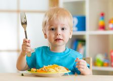 Kid eating healthy food at home. Or kindergarten stock images
