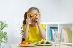Kid eating healthy food in kindergarten or home Stock Images