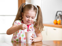 Kid eating healthy food in kitchen Royalty Free Stock Photo