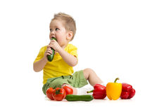 Kid eating healthy food and looking aside Royalty Free Stock Photo