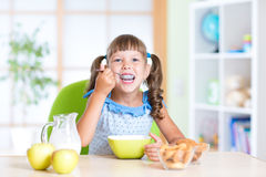 Kid eating Healthy Food in Nursery Royalty Free Stock Images