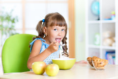 Kid eating Healthy Food in Nursery Stock Photography