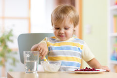 Kid eating healthy food at nursery room Royalty Free Stock Images