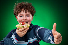 Kid eating healthy sandwiches Stock Images