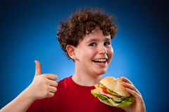 Kid eating healthy sandwiches Royalty Free Stock Photos