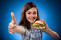 Kid eating healthy sandwiches Royalty Free Stock Image