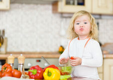 Kid eating healthy vegetables meal Royalty Free Stock Image